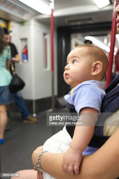 Hong Kong, Eurasian Baby Boy traveling on a Train
