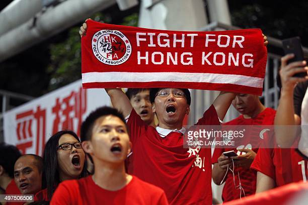 Hong Kong fans cheer their team during a world cup qualifier at Mong Kok stadium in Hong Kong on November 17 2015 Hong Kong fans booed the anthem...