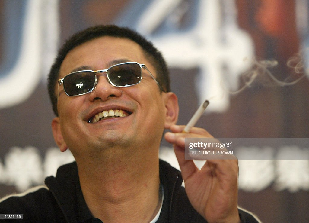 Hong Kong film director Wong Kar-wai reacts to questions during a press conference in Beijing, 25 September 2004, for his new film '2046' which stars actor Tony Leung, actress-singer Faye Wong and Zhang Ziyi. The sci-fi film came away without any major prize but was the toast of the Cannes film festival in France earlier this year. AFP PHOTO/Frederic J. BROWN .