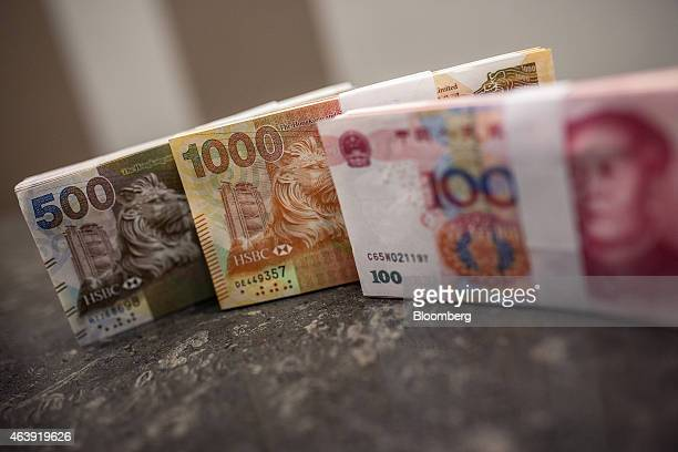 Hong Kong five hundred dollar banknotes one thousand dollar banknotes and Chinese one hundred yuan banknotes are arranged for a photograph inside the...