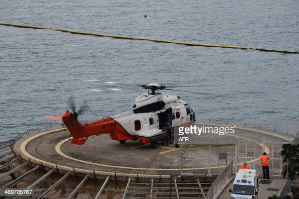 A Hong Kong government helicopter evacutes an injured man at Cheung Chau Island near Hong Kong on February 16 2014 Cheung Chau Island is not...
