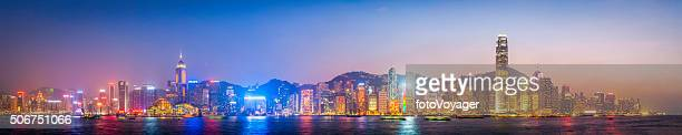 Hong Kong harbour futuristic skyscraper cityscape panorama at sunset China