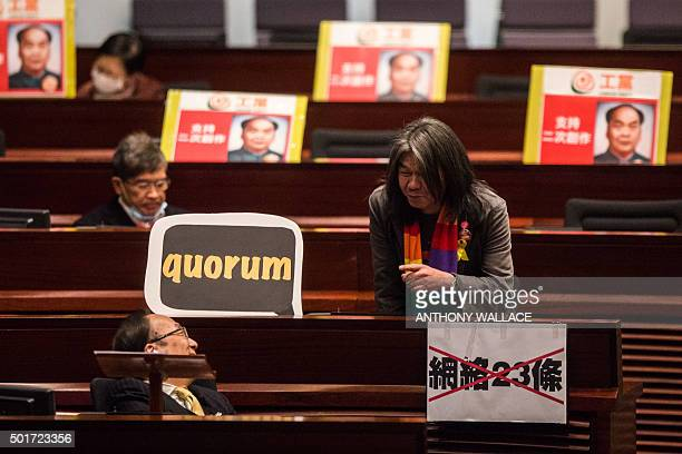 Hong Kong legislator Leung Kwokhung known as 'Long Hair' of the League of Social Democrats speaks to leader of Civic Party Alan Leung Kahkit during a...