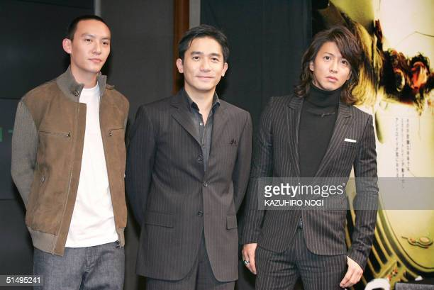 Hong Kong movie star Tony Leung Taiwanese actor Chang Chen and Japanese actor Takuya Kimura pose during a photo session at a press conference to...