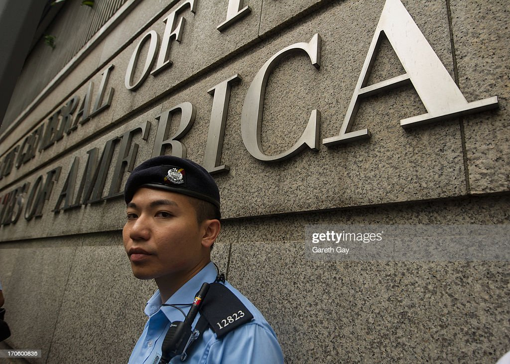 A Hong Kong Police officer, standing guard outside the American Consulate in Hong Kong during a demonstration of support for Edward Snowden, on June 15, 2013 in Hong Kong, Hong Kong. Former CIA employee Edward Snowden is accused of leaking details of top-secret US surveillance of phones and internet.