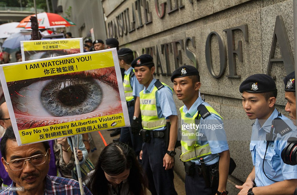 Hong Kong Police officers standing guard outside the American Consulate in Hong Kong during a demonstration of support for Edward Snowden, on June 15, 2013 in Hong Kong, Hong Kong. Former CIA employee Edward Snowden is accused of leaking details of top-secret US surveillance of phones and internet.