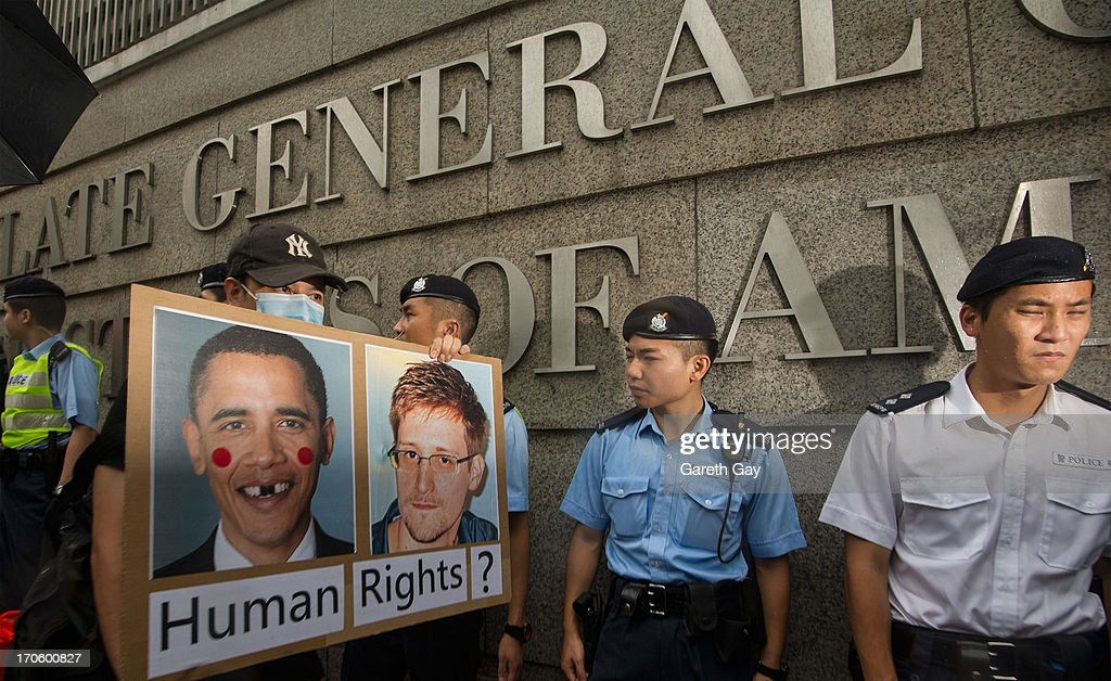 Hong Kong Police officers standing guard outside the American Consulate in Hong Kong during a demonstration of support for <a gi-track='captionPersonalityLinkClicked' href=/galleries/search?phrase=Edward+Snowden&family=editorial&specificpeople=10983676 ng-click='$event.stopPropagation()'>Edward Snowden</a>, on June 15, 2013 in Hong Kong, Hong Kong. Former CIA employee <a gi-track='captionPersonalityLinkClicked' href=/galleries/search?phrase=Edward+Snowden&family=editorial&specificpeople=10983676 ng-click='$event.stopPropagation()'>Edward Snowden</a> is accused of leaking details of top-secret US surveillance of phones and internet.