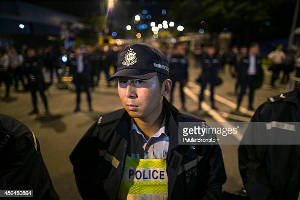 Hong Kong police stand guard as protesters confront them overnight outside the legislative government complex on October 2 2014 in Hong Kong Hong...