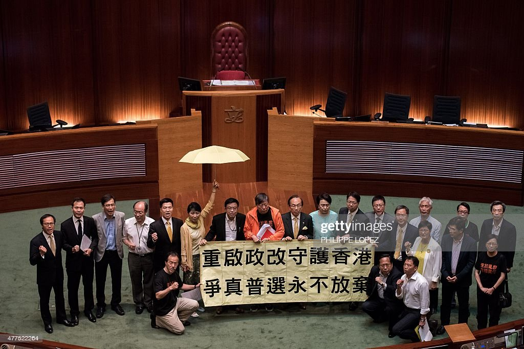 Hong Kong prodemocracy lawmakers display a banner after a vote at the city's legislature in Hong Kong on June 18 2015 Hong Kong lawmakers rejected a...