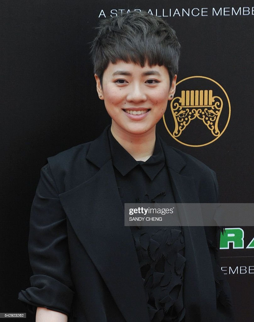 Hong Kong singer Yoyo Sham arrives to attend the 27th Golden Melody Awards in Taipei on June 25, 2016. Some of Mandarin pop's biggest names have gathered for the annual Golden Melody music awards, with singers, songwriters and composers from Taiwan, China, Hong Kong, Singapore and Malaysia competing in more than 20 categories. / AFP / SANDY