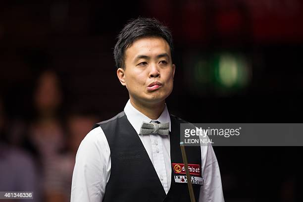 Hong Kong snooker player Marco Fu looks on during his first round match against England's Stuart Bingham at the Masters snooker tournament at...