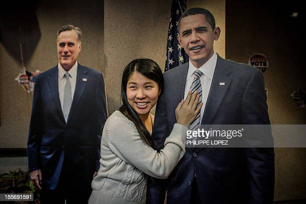 A Hong Kong student poses with a cut out of US President Barack Obama during an election day at the US consulate in Hong Kong on November 7 2012...