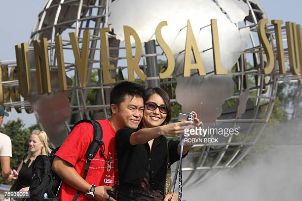 Hong Kong tourist Mike Wong and his wife visit Universal Studios Hollywood in University City California 02 August 2007 Universal Studios is a...