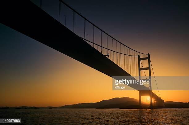 Hong Kong Tsing Ma Bridge in silhouette at sunset