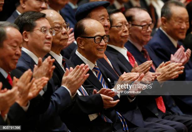 Hong Kong tycoon Li Kashing applauds as visiting Chinese President Xi Jinping speaks at a photo session in Hong Kong on June 30 2017 Xi and his wife...