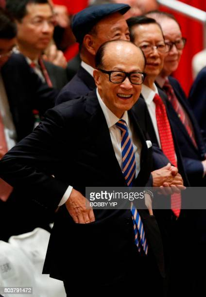 Hong Kong tycoon Li Kashing reacts after a photo session with Chinese President Xi Jinping in Hong Kong on June 30 2017 Xi and his wife arrived in...