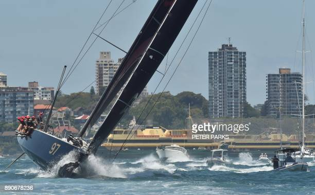 Hong Kong yacht Beau Geste races in the SOLAS Big Boat Challenge on Sydney Harbour on December 12 2017 / AFP PHOTO / PETER PARKS / IMAGE RESTRICTED...