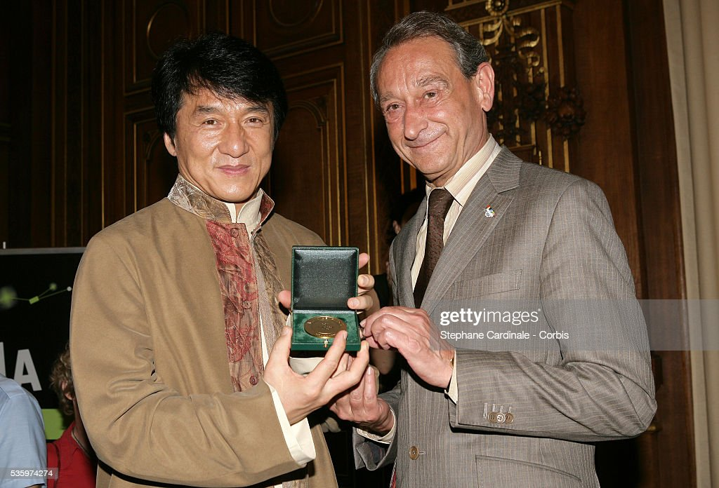 Hong Kong-born martial arts actor, Jackie Chan receives 'La Medaille Grand Vermeil de la Ville de Paris' from Paris Mayor, Bertrand Delanoe.
