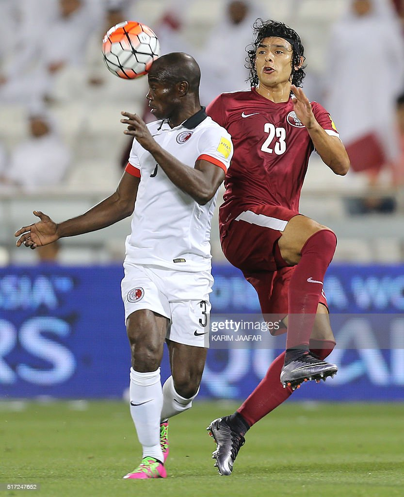 Hong Kong's Baise Festus heads the ball as he is defended by Qatar's Sebastian Soria during of their World Cup 2018 Asian qualifying football match...