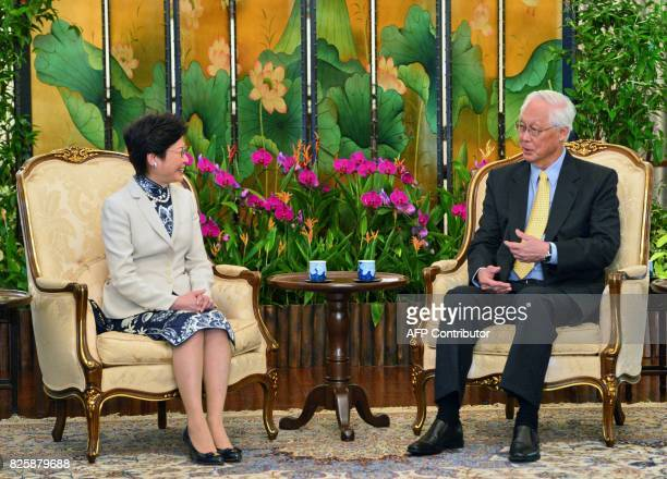 Hong Kong's Chief Executive Carrie Lam chats with Singapore Emeritus Senior Minister Goh Chok Tong during a call at Istana presidential palace in...