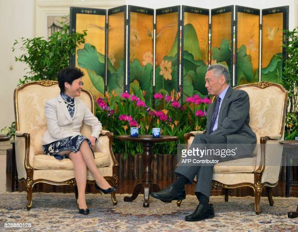 Hong Kong's Chief Executive Carrie Lam chats with Singapore's Prime Minister Lee Hsien Loong during a call at Istana presidential palace on in...
