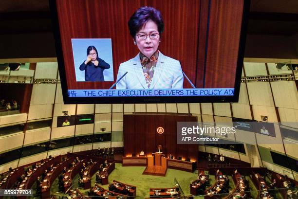 Hong Kong's Chief Executive Carrie Lam is shown on a live feed as she delivers her first policy address in the main chamber of the Legislative...