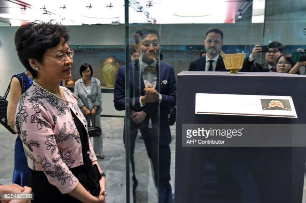 Hong Kong's Chief Executive Carrie Lam looks at a gold cup during her tour of the Tang Shipwreck Gallery at the Asian Civilisation Museum in...