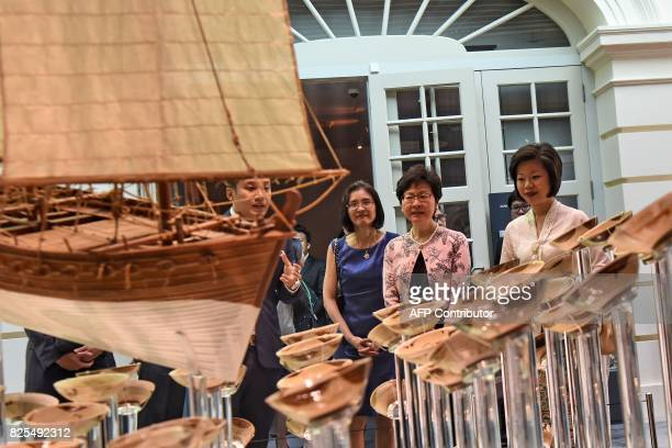 Hong Kong's Chief Executive Carrie Lam looks at exhibits in the Tang Shipwreck Gallery at the Asian Civilisation Museum in Singapore on August 2 2017...