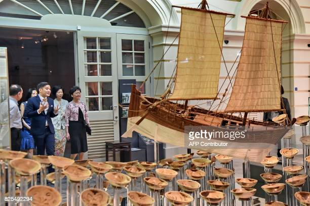 Hong Kong's Chief Executive Carrie Lam looks at the exhibits of the Tang Shipwreck Gallery at the Asian Civilisation Museum in Singapore on August 2...
