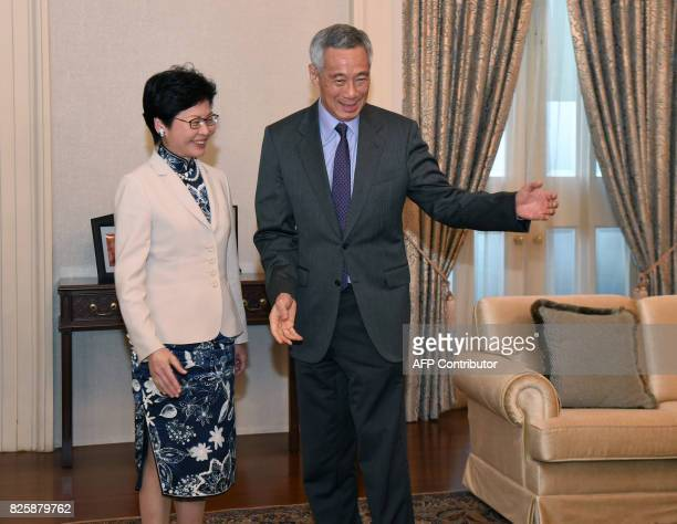 Hong Kong's Chief Executive Carrie Lam meets with Singapore Prime Minister Lee Hsien Loong during a call at Istana presidential palace in Singapore...