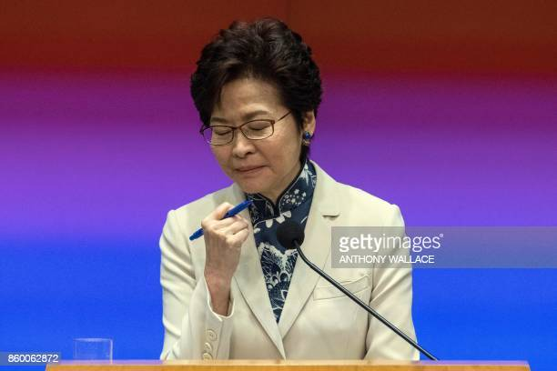 Hong Kong's Chief Executive Carrie Lam pauses while answering a question during a press conference after her first policy address at the Legislative...