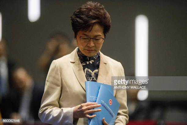 Hong Kong's Chief Executive Carrie Lam reacts as she arrives for a press conference after delivering her first policy address at the Legislative...