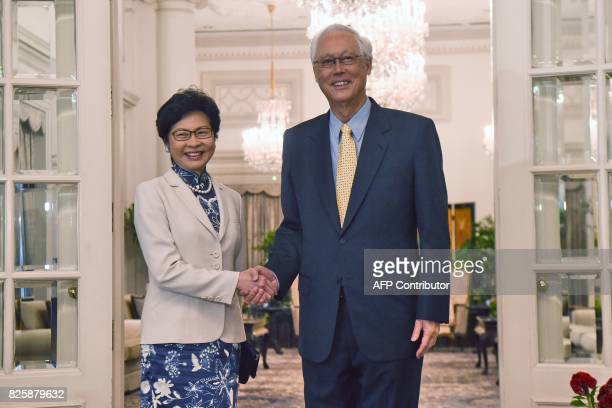 Hong Kong's Chief Executive Carrie Lam shakes hands with Singapore Emeritus Senior Minister Goh Chok Tong during a call at Istana presidential palace...