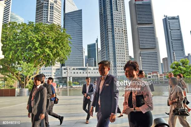 Hong Kong's Chief Executive Carrie Lam walks in for tour of the Tang Shipwreck Gallery at the Asian Civilisation Museum in Singapore on August 2 2017...