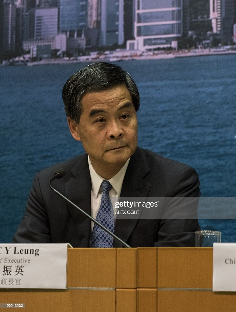 Hong Kong's Chief Executive Leung Chunying listens to a question during a press conference in Hong Kong on September 28 2014 Activists massed outside...