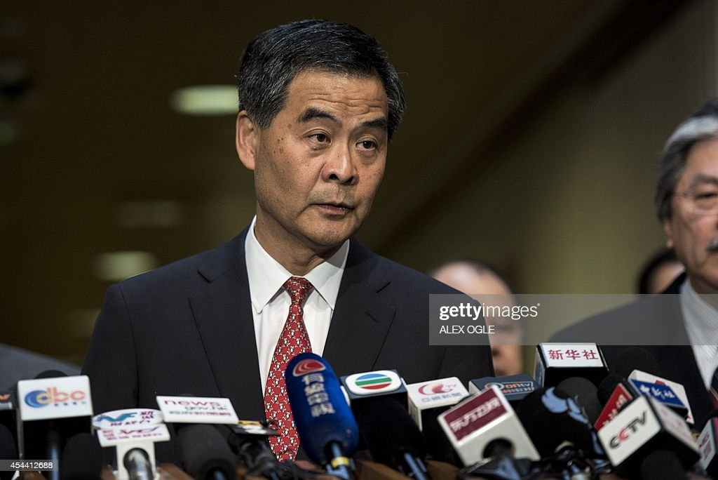 Hong Kong's Chief Executive Leung Chunying listens to a question at a press conference on political reform at the government headquarters in Hong...
