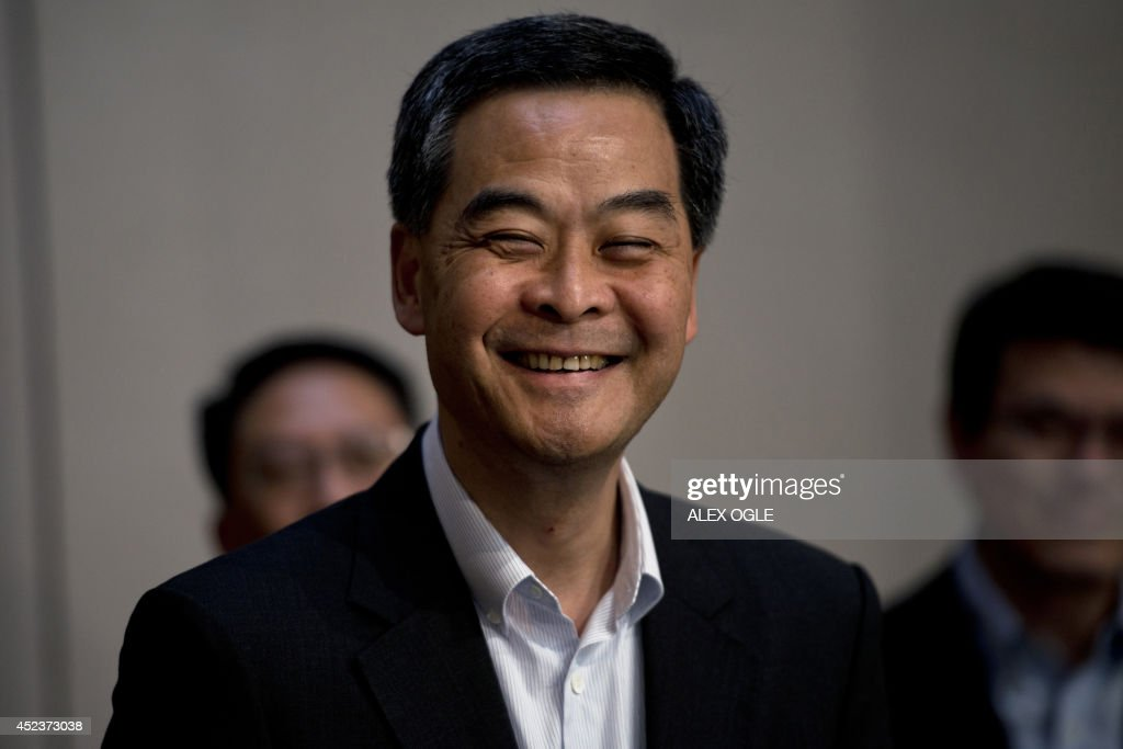 Hong Kong's Chief Executive Leung Chun-ying smiles before answering a question at a press conference on political reform in the southern Chinese city, at the government headquarters in Hong Kong on July 19, 2014. An unofficial referendum on how Hong Kong's next leader should be chosen drew a massive turnout of almost 800,000 people in June, angering Beijing, and it was followed by a huge pro-democracy march on July 1 that organisers said was the biggest protest since the 1997 handover.