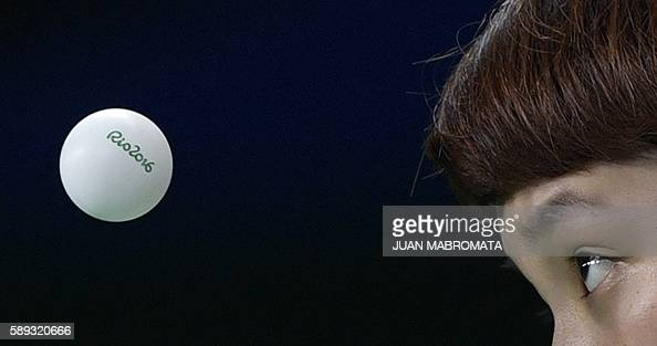 TOPSHOT Hong Kong's Doo Hoi Kem eyes the 'Rio 2016' branded table tennis ball as she serves in the women's team quarterfinal table tennis match...
