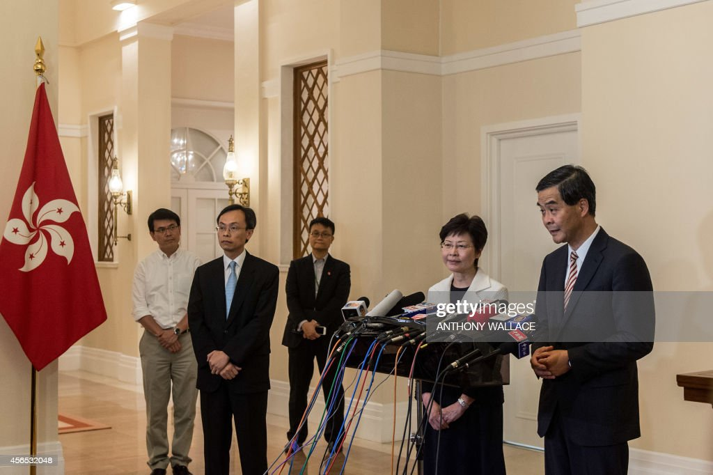 Hong Kong's embattled leader Chief Executive Leung Chunying and Chief Secretary Carrie Lam hold a press conference at Leung's official residence in...