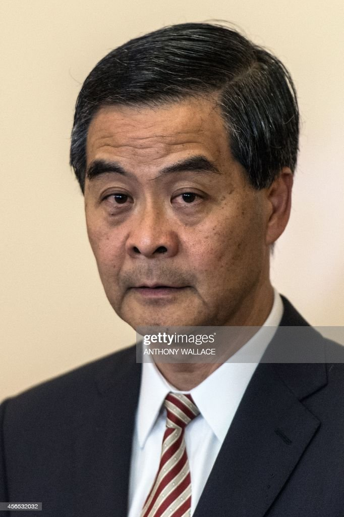 Hong Kong's embattled leader Chief Executive Leung Chunying listens to a question during a press conference at his official residence in Hong Kong on...