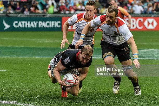 Hong Kong's Jamie Hood dives to score against Germany during their match on the third day of the Hong Kong Rugby Sevens tournament on April 10 2016 /...