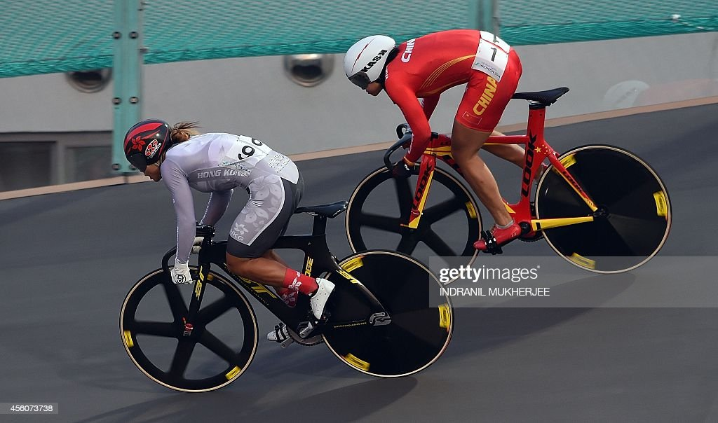 Hong Kong's Lee Wai Sze sprints against China's Zhong Tianshi during the women's sprint final of the 2014 Asian Games at the Samsan World Gymnasium...