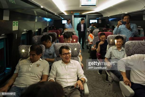 Hong Kong's Legislative Council member Gary Chan Hakkan sits in a carriage of the GuangzhouShenzhenHong Kong Express Rail Link in Hong Kong on August...
