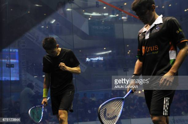 Hong Kong's Max Lee celebrates after winning India's Sourav Ghosal during their men's final match at the 19th Asian Squash Championship in Chennai on...