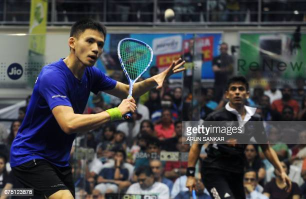 Hong Kong's Max Lee plays a shot against India's Sourav Ghosal during their men's final match at the 19th Asian Squash Championship in Chennai on...