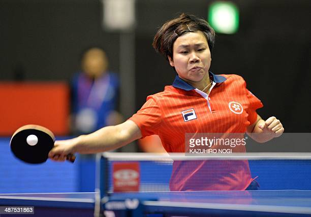 Hong Kong's Ng Wing Nam returns a shot against Croatia's Petra Petek during their match in the women's team championship division group D at the 2014...