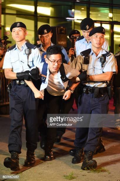 Hong Kong's youngest lawmaker and former Umbrella Movement leader Nathan Law is detained by police after he and other demonstrators staged a sitin...