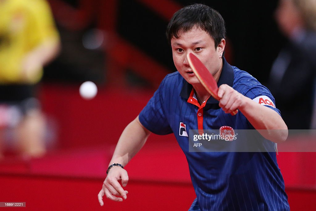 Hong Kong's Yuk Cheungplays against China's Hao Wang on May 16, 2013 in Paris, during the second round of the Men's Singles of the World Table Tennis Championships. AFP PHOTO/THOMAS SAMSON