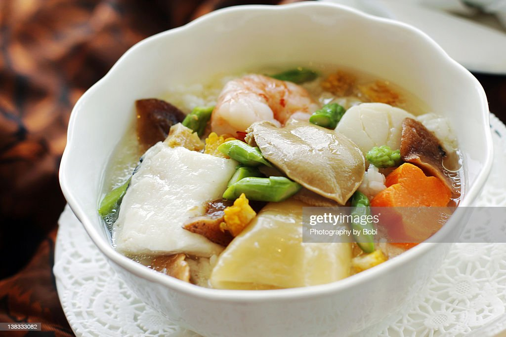 Hong Kong-style food of seafood rice with soup : Stock Photo