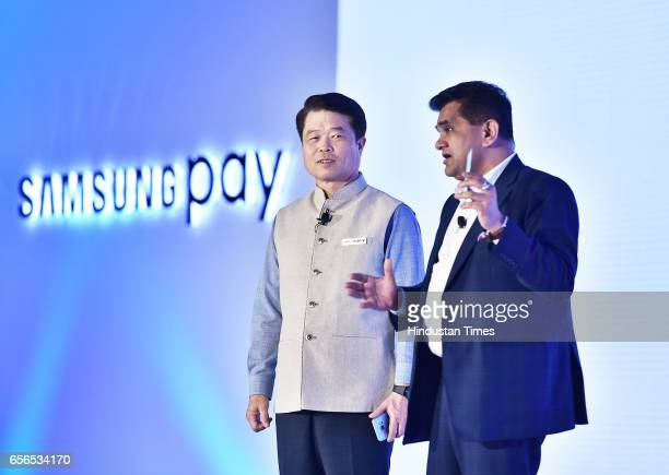 Hong President and CEO of Samsung Electronics Southwest Asia with Amitabh Kant CEO NITI Aayog launches new digital payment service 'Samsung Pay' on...